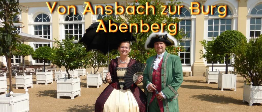 Ansbach, Hofgarten. Rokoko-Paar posiert vor der Orangerie